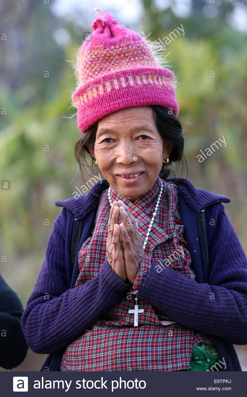 Portrait of a nepalese catholic christian woman greeting with